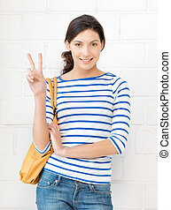 victory - bright picture of lovely teenage girl showing...