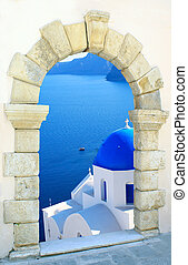 Traditional greek church through an old window in Santorini...