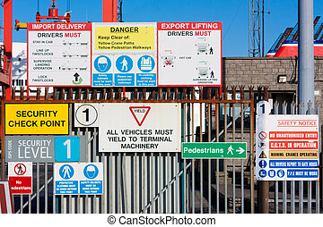 Lots of warning signs in a sea port