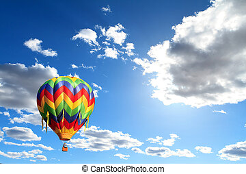 hot air balloon - colorful hot air balloon over cloudy sky