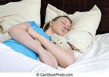 Young girl fell asleep with teddy bear