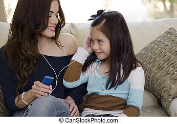 Mom and daughter listening to music