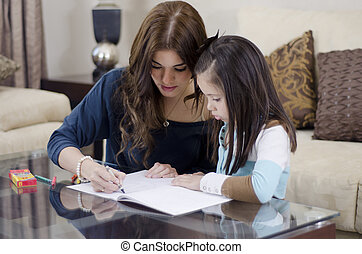 Mom and daughter coloring a book