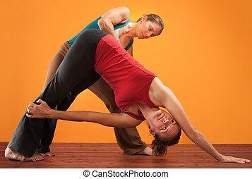 Yogasana Instructor and Student - Yogasana instructor with...