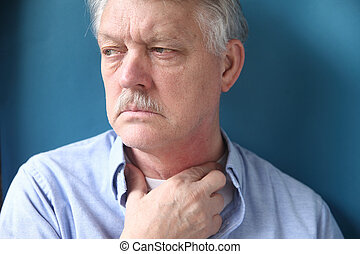 businessman with hand at throat - senior man with throat or...