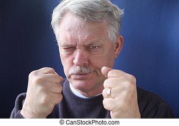 hostile and combative senior man - belligerent older man is...