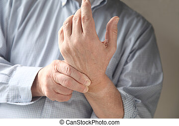man has pain in wrist - businessman checks the soreness in...