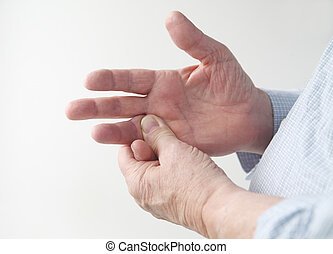 man with sore finger - a man rubs the pain in his finger