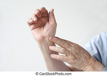 man with an aching wrist - man indicates where the pain is...