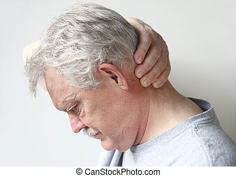man with headache at base of skull