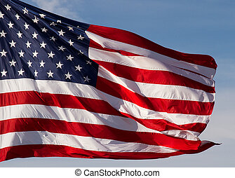 USA Flag Flying - United States Flag flying against a deep...
