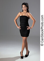 beautiful woman with elegant black dress, studio shot