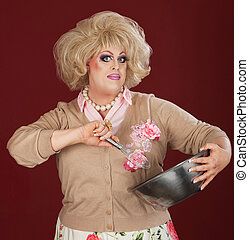 Drag Queen With Bowl and Whisk - Serious man in drag working...