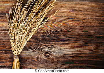 bunch of wheat ears on wood background