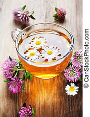 hot herbal tea with clover and chamomile