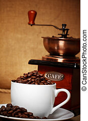 dark coffee still life with retro grinder