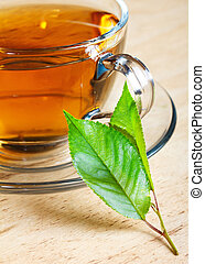 hot tea with green leaf