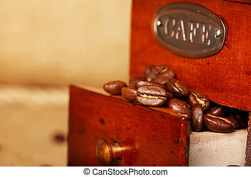 coffee grinder with beans closeup