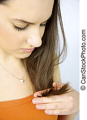 Female model looking unhealthy hair split ends - Female...