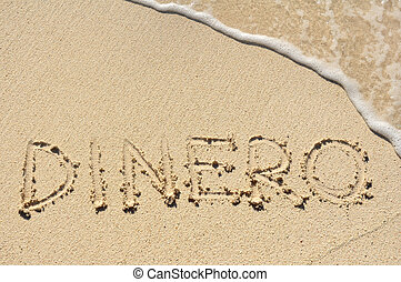 Dinero Written in the Sand on a Beach - Dinero Money Written...