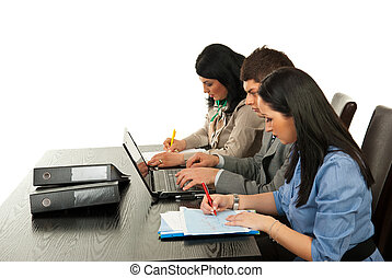 Business people being busy - Three business working in...