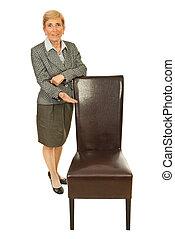 Senior executive invite you to sit - Senior executive woman...