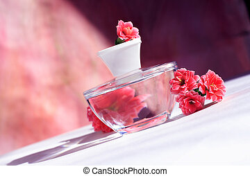 perfumes - perfume bottle with red flowers with reflection.