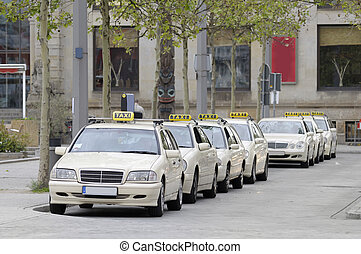 Taxis in a row - This photograph represent taxis lined up on...