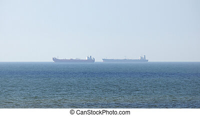 Container ships in distance - This photograph represent two...