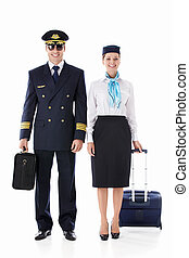 Airlines - The pilot and flight attendant with a suitcase on...