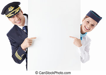 Advertising - The pilot and flight attendant with a...