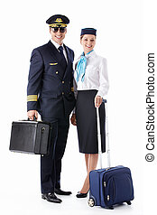 Professions - The pilot and flight attendant with a suitcase...