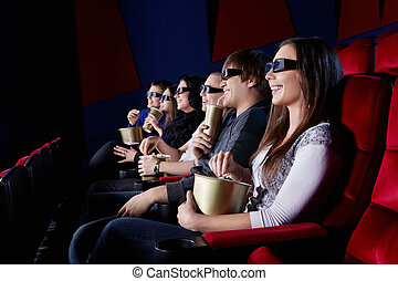 Audience - People watch a movie in 3D glasses in the cinema