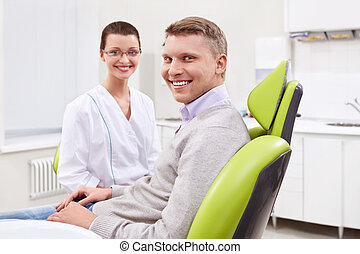 The patient at the dentist - The dentist and the patient in...