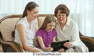Be modern - Femails of three generations using modern...