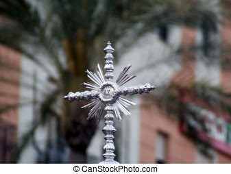 Silver cross in a procession of Holy Week in Spain