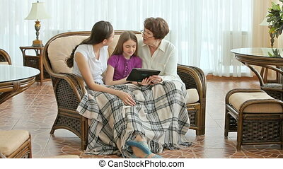 Technologies for everyone - Grandmother and granddaughters...