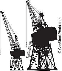 Dockyard cranes - Silhouette of a dockyard cargo crane, two...