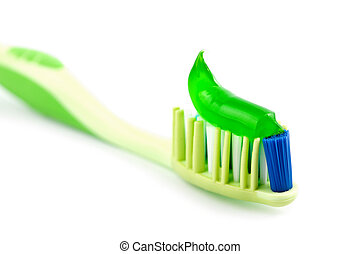 toothbrush with green toothpaste isolated
