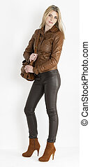 standing woman wearing brown clothes and fashionable brown...