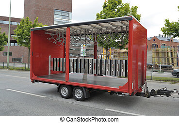 Empty bike trailer - This photograph represent an empty red...