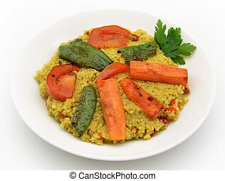 Couscous with vegetables served on a plate
