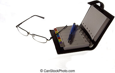 glasses, pen and notebook