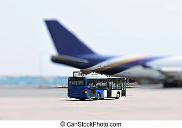Airport bus and plane - This photograph represent an Airport...