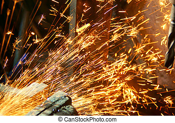 Spark wheel - Worker cutting metal with many sharp sparks