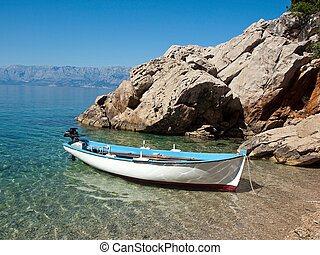 View at small boat near the beach