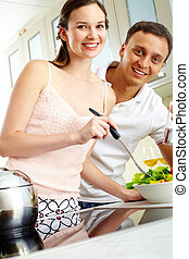 Tasting salad - Portrait of happy couple looking at camera...