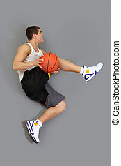 Tricky jump - Basketball player executing a tricky jump with...