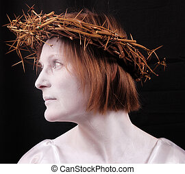 woman - A woman with a white face and crown of thorns