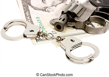 Pistol handcuffs money isolated on white